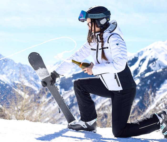 Sabering champagne bottle with a ski