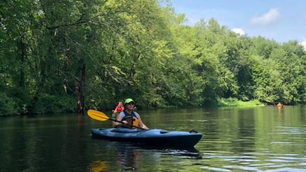 Paddlers enjoy a river in New England