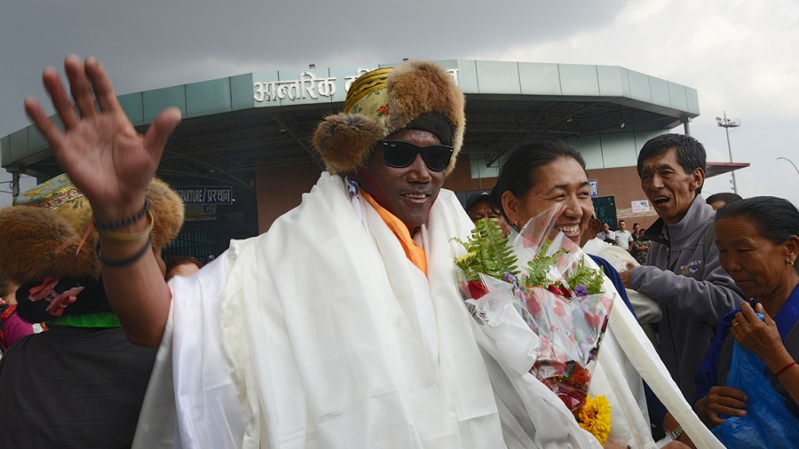 Nepali mountaineer Kami Rita Sherpa, 48, who broke his own world record for the most Everest summits, gestures after arriving in Tribhuvan airport in Nepal's capital Kathmandu on May 20, 2018. - Kami Rita Sherpa broke his own world record for the most Everest summits on May 16 by reaching the world's highest peak for the 22nd time. (Photo by PRAKASH MATHEMA / AFP) (Photo credit should read PRAKASH MATHEMA/AFP/Getty Images)