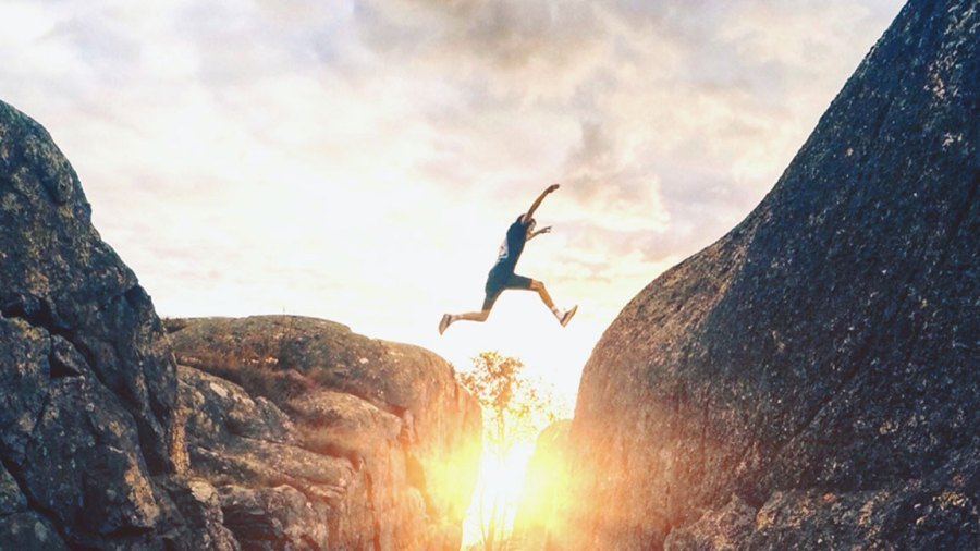 Man jumping on cliff