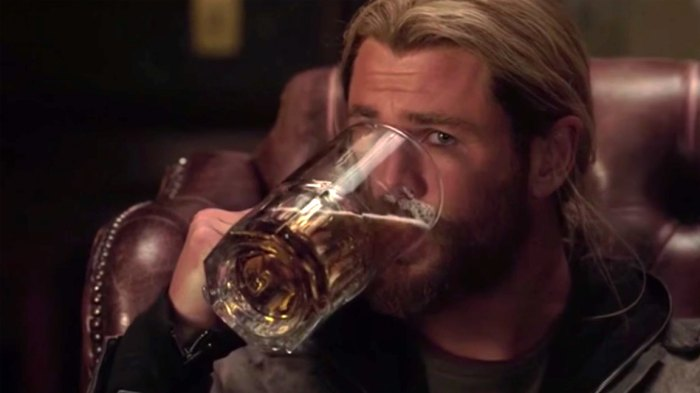 Chris Hemsworth as Thor, drinking beer in Thor: Ragnarok