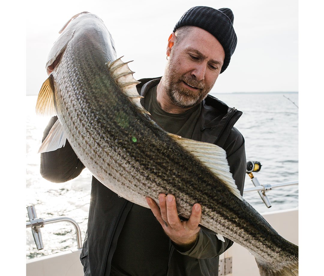 Claes Claesson holds 44-inch striped bass
