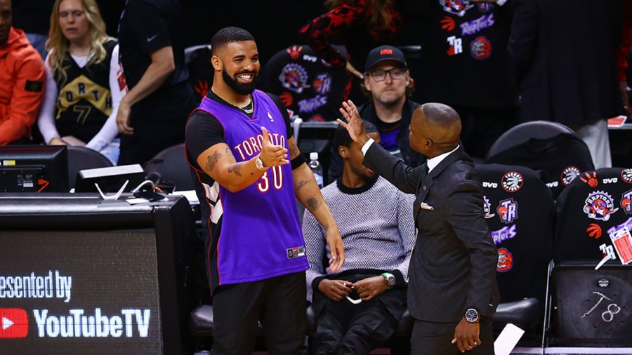 TORONTO, ONTARIO - MAY 30: Rapper Drake is seen wearing a Dell Curry jersey before Game One of the 2019 NBA Finals between the Golden State Warriors and the Toronto Raptors at Scotiabank Arena on May 30, 2019 in Toronto, Canada. NOTE TO USER: User expressly acknowledges and agrees that, by downloading and or using this photograph, User is consenting to the terms and conditions of the Getty Images License Agreement. (Photo by Vaughn Ridley/Getty Images)