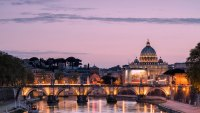 Dusk on Tiber River with bridge Umberto I and Basilica di San Pietro in the background, Rome,