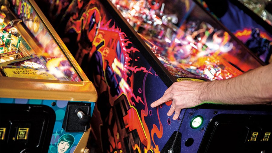 A pinball player works the flippers.