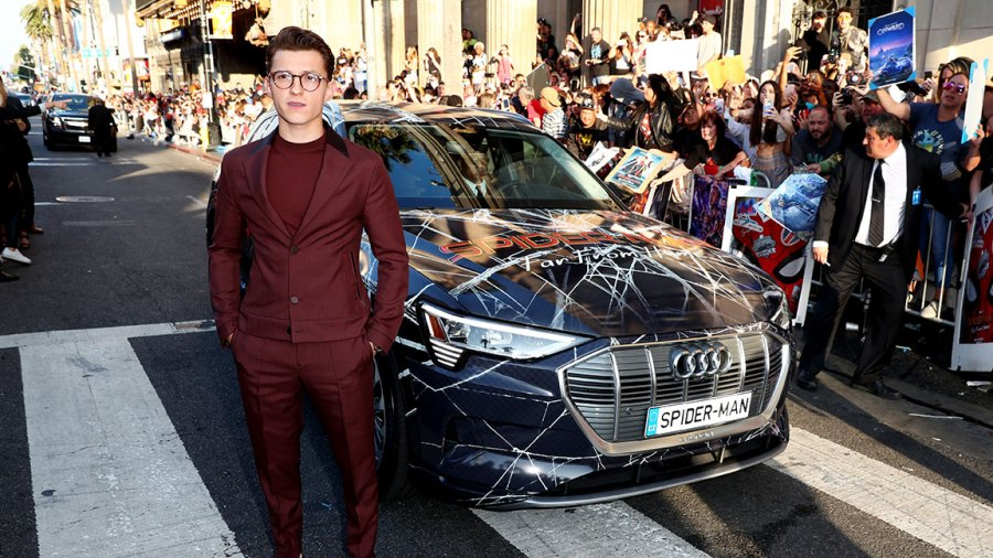 Audi At The World Premiere Of 'Spider-Man: Far From Home' Description - LOS ANGELES, CALIFORNIA - JUNE 26: Tom Holland arrives in a custom Spider-Man Audi e-tron SUV at the World Premiere of Spider-Man: Far From Home at the TCL Chinese Theatre on June 26, 2019 in Hollywood, California. (Photo by Joe Scarnici/Getty Images for Audi)