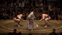 TOKYO, JAPAN - SEPTEMBER 17: Wrestlers face off during the Tokyo Grand Sumo tournament at the Ryogoku Kokugikan on September 17, 2015 in Tokyo, Japan. Japanese Sumo is an anciant sport dating back some 1500 years. The first sumo matches were part of a prayer ritual dedicated to the gods for a good harvest season. Original sumo matches combined crude boxing and wrestling techniques before rules were formed to shape it into its current form. Today there are six Grand Tournaments per year held across Japan, each tournament lasting 15 days. The Rikishi (wrestler) strive to move through the ranks to be eligible to win the grand prize, the Emperors Cup. (Photo by Chris McGrath/Getty Images)