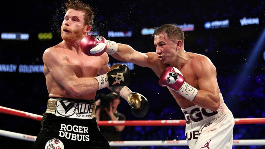 LAS VEGAS, NV - SEPTEMBER 15: Gennady Golovkin punches Canelo Alvarez during their WBC/WBA middleweight title fight at T-Mobile Arena on September 15, 2018 in Las Vegas, Nevada. (Photo by Al Bello/Getty Images)