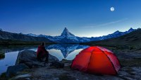 Camper under full Moon at Matterhorn in Switzerland