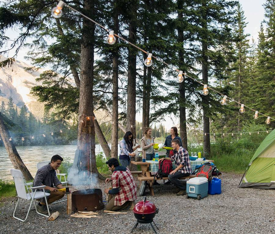 Friends hanging out at lakeside campsite