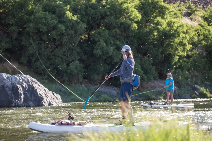 Two women fish from stand-up paddleboards on Oregon's John Day River.