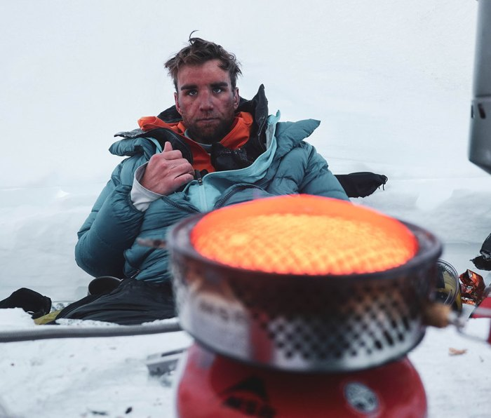 Mike Chambers warms up after Denali descent with 70 mph winds
