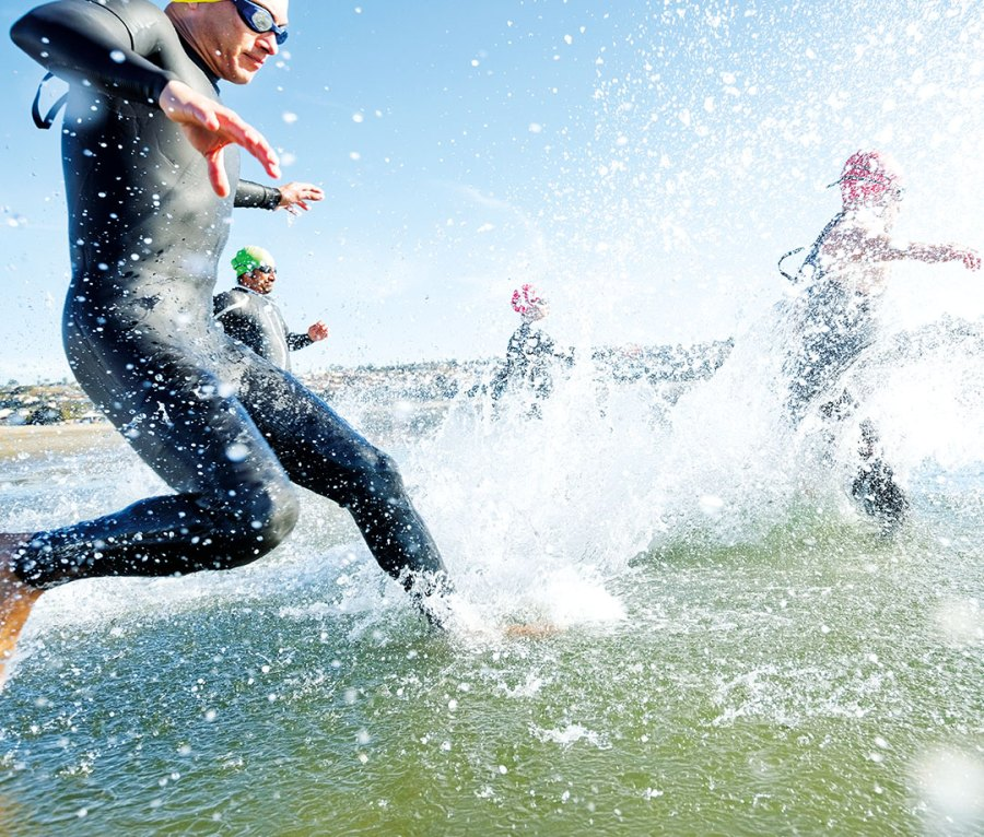 Swimmers entering the surf at a competition