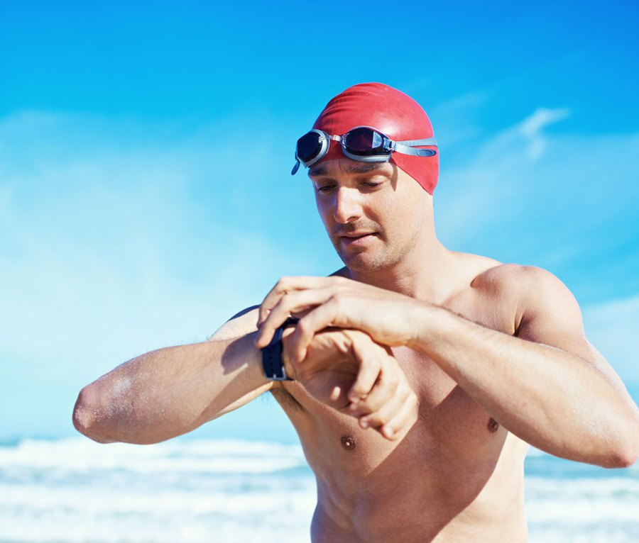 Swimmer checking smartwatch
