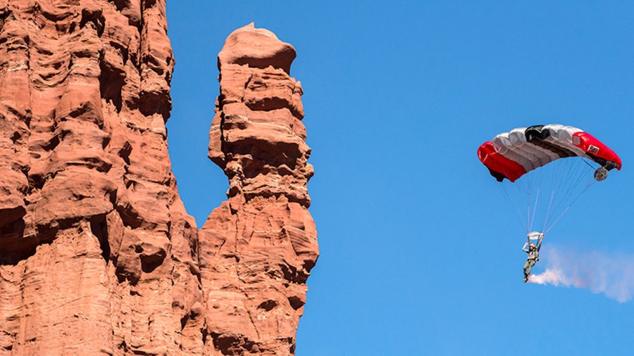 Andy Lewis (upper) and JT Holmes come in to land from a B.A.S.E. jump from the tower known as Titan, part of the Fisher Towers near Moab, UT, USA on 28 October, 2014.