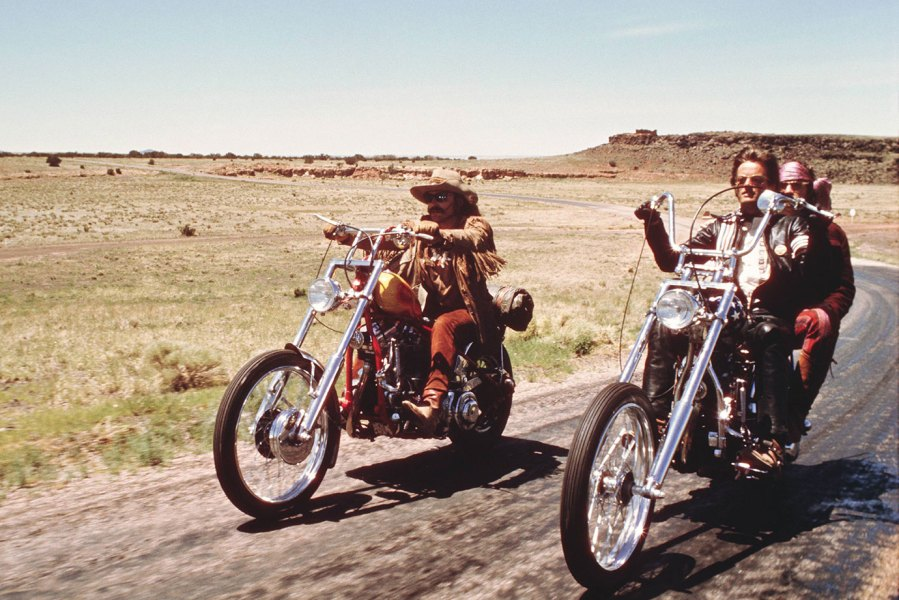 Dennis Hopper (1936-2010) and Peter Fonda riding their chopper motorcycles, with Luke Askew on the back of his motorcyle, in a publicity still issued for the film, 'Easy Rider', USA, 1969. The film, directed by Dennis Hopper, starred Hopper as 'Billy', Fonda as 'Wyatt', and Askew as the 'stranger on highway'. (Photo by Silver Screen Collection/Getty Images)