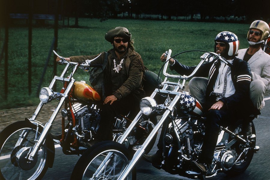 1969, From left to right: American actors Dennis Hopper, Jack Nicholson and Peter Fonda ride through the countryside on motorcycles in a still from the film 'Easy Rider' directed by Hopper. (Photo by Columbia Tristar/Getty Images)