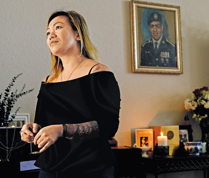 Ngo Pham, wife of Miguel Colon Vazquez, at their former house in Killeen, with a memorial to her late husband, at right.