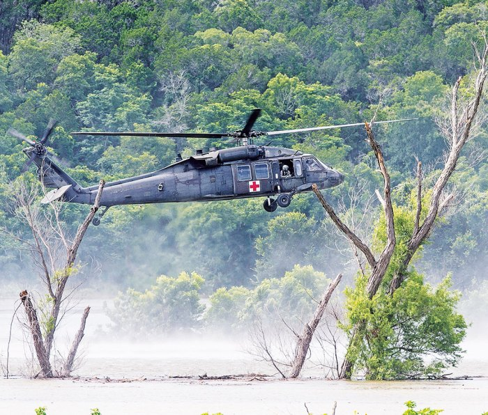 An Army helicopter searches for the missing soldiers swept away in Owl Creek.