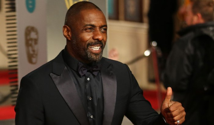British actor Idris Elba poses on arrival for the BAFTA British Academy Film Awards at the Royal Opera House in London on February 14, 2016. AFP PHOTO / JUSTIN TALLIS / AFP / JUSTIN TALLIS (Photo credit should read JUSTIN TALLIS/AFP/Getty Images)