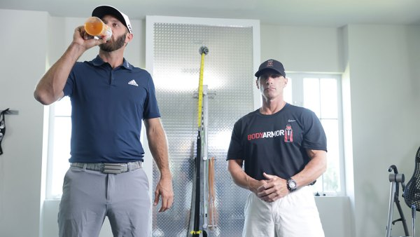 Dustin Johnson and trainer Joey Diovisalvi