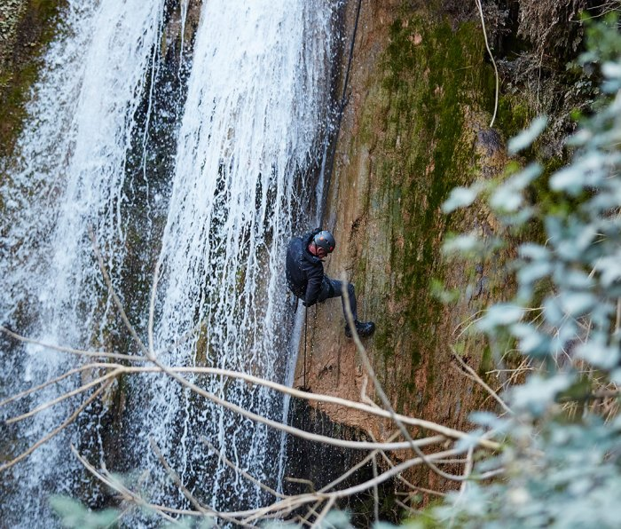 """Gordon Ramsay rappelling down a waterfall in his new Nat Geo show, """"Uncharted"""""""