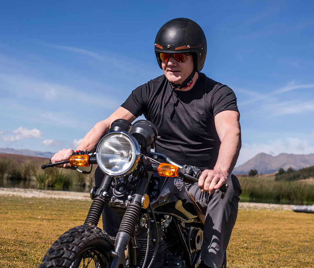"Ramsay on a motorcycle in his new Nat Geo show, ""Uncharted"""