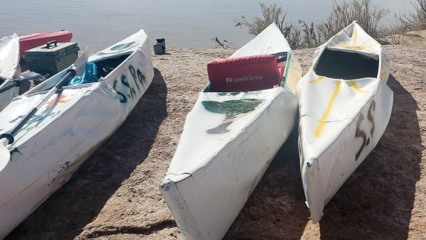 Homemade canoes on the banks of the Green River