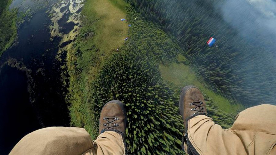 Matt Oakleaf drops himself with the camera in his pocket behind the rest of his team on a landing pad near a smoldering boreal forest. Jumpers can invest 100 pounds of equipment and board a plane in minutes. Your mission: extinguish fires before they get out of control. (Photo by Mark Thiessen / National Geographic)