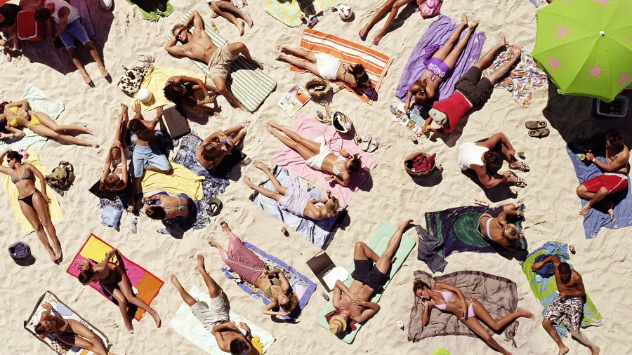 A crowd of sunbathers