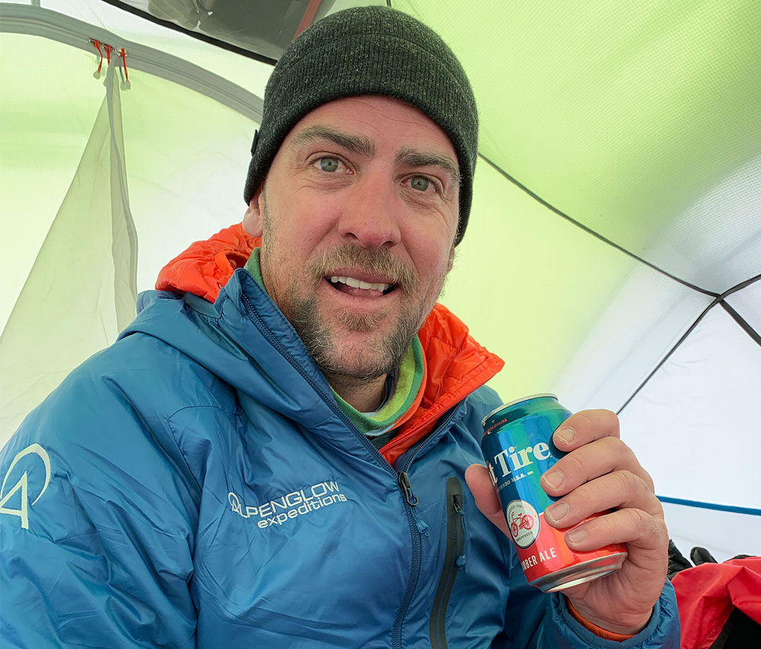 Rob Lea drinking Fat Tire beer at Everest camp