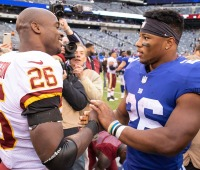 Adrian Peterson talks to Saquon Barkley at MetLife Stadium in Rutherford, NJ, on Oct. 28, 2018