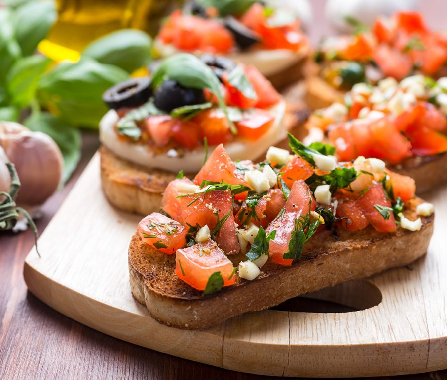Bruschetta with tomatoes, garlic, basil, and mozzarella