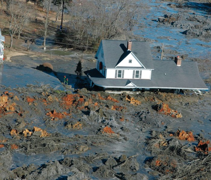 A home buried in coal ash following the 2008 Kingston Fossil Plant spill.