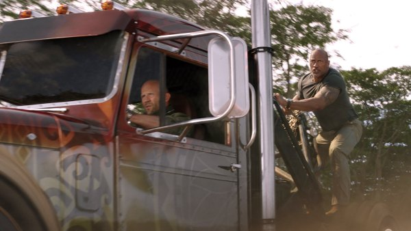 "Deckard Shaw (Jason Statham) and Luke Hobbs (Dwayne Johnson) drive a modified Peterbilt truck in ""Hobbs & Shaw"""