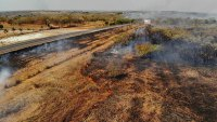 Amazon Fires, Cuiaba, Brazil - 25 Aug 2019 Fire consumes a field along the BR 070 highway near Cuiaba, Mato Grosso state, Brazil, . Leaders of the Group of Seven nations said Sunday they were preparing to help Brazil fight the fires burning across the Amazon rainforest and repair the damage even as tens of thousands of soldiers were being deployed to fight the blazes that have caused global alarm