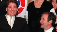 REEVE WILLIAMS Actor Robin Williams, right, looks up at his friend and colleague Christopher Reeve as they pose for photographers at an American Paralysis Association dinner in New York . Reeve, himself a spinal injury victim, is the current chairman of the board of the association