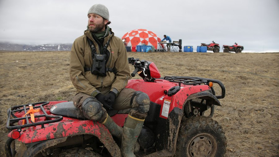 Kingdom of the White Wolf - Eureka, Nunavut, Canada - Ronan Donovan sitting on ATV near base camp. (Market Road Films/Tony Gerber)