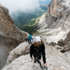 Hiking a via ferrata in Dolomites, Italy