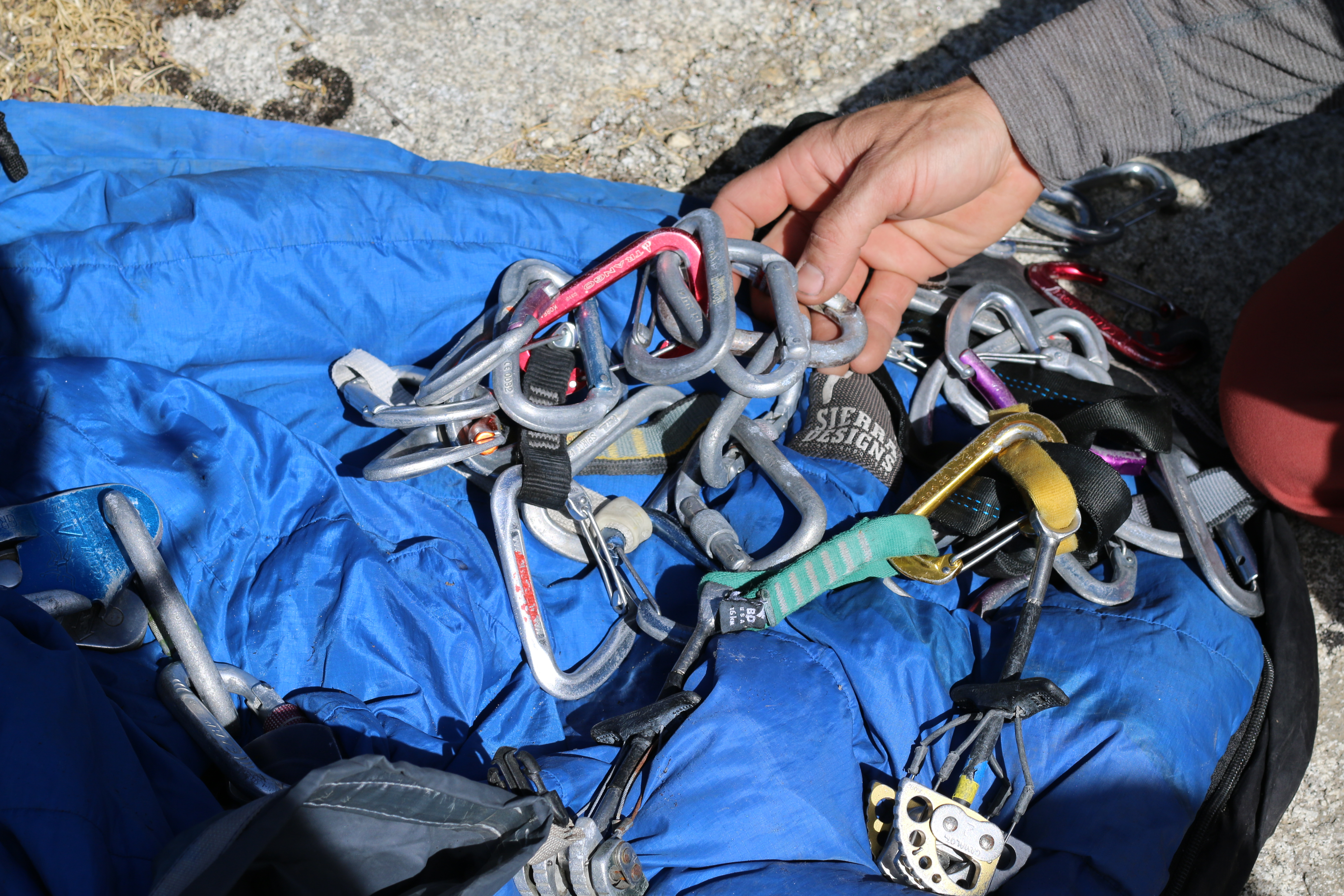 Old Cams and carabiners on a sling