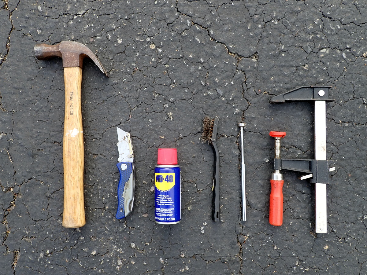 Hammer, utility knife, WD-40, wire brush, telescoping magnet, bar clamp.