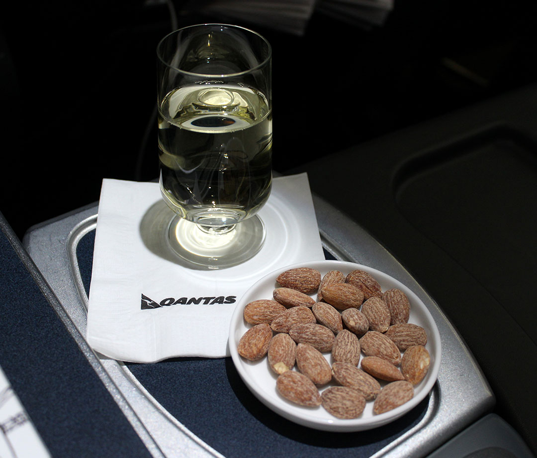 Qantas serves its business class passengers wine and snacks