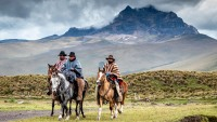 Vacqueros on horseback in Cotopaxi National Park in Ecuador