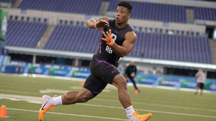 NFL Combine Football, Indianapolis, USA - 02 Mar 2018 Penn State running back Saquon Barkley runs a drill at the NFL football scouting combine in Indianapolis 2 Mar 2018