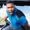 Strahan wears MSX Polo and Chino's by Michael Strahan. Shoes by G/Fore. Watch by IWC Big Pilot.
