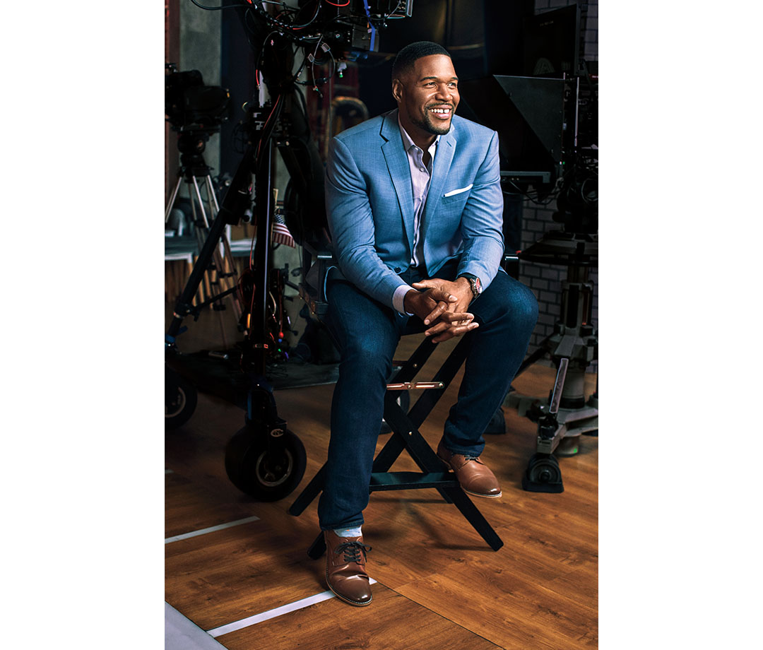 At 47 years old, Michael Strahan experienced the apex of his football career when he was inducted into the 2014 Pro Football Hall of Fame. Jacket, shirt, jeans and shoes by Collection Michael Strahan. Watch by Roger Dubuis.