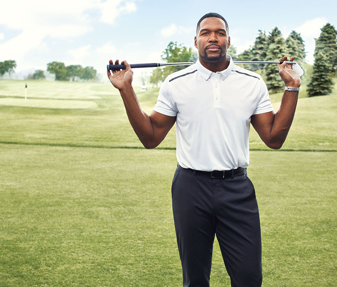 Strahan wears MSX Polo and Chino's by Michael Strahan. Watch by Rolex Daytona.