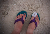 Teva flip-flops worn while on assignment on a remote atoll in the South Pacific.