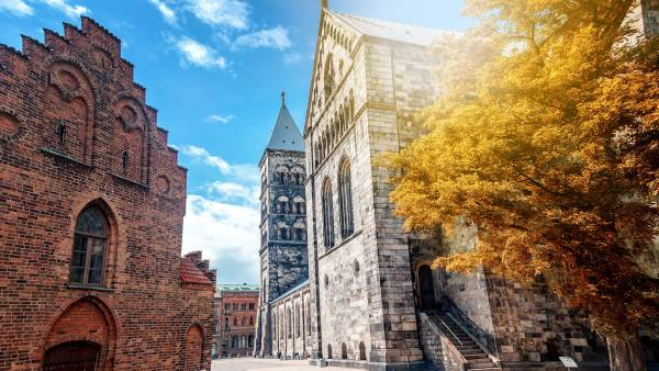 The main Lutheran Gothic temple in Lund, Sweden, a monument of medieval architecture, a trip to Sweden. Autumn city landscape