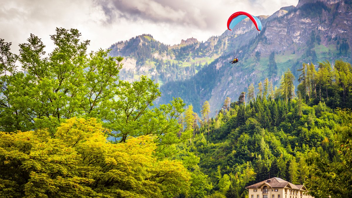 Picturesque Paragliding, Authentic Fondue, and a Trip to the Top of Europe: The 4-Day Weekend in Switzerland